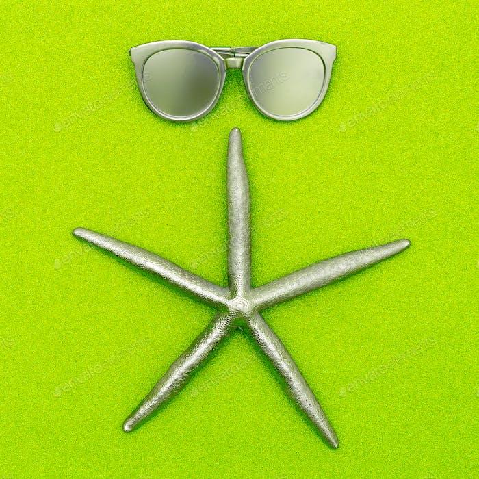 Starfish and sunglasses. Silver. Minimal art