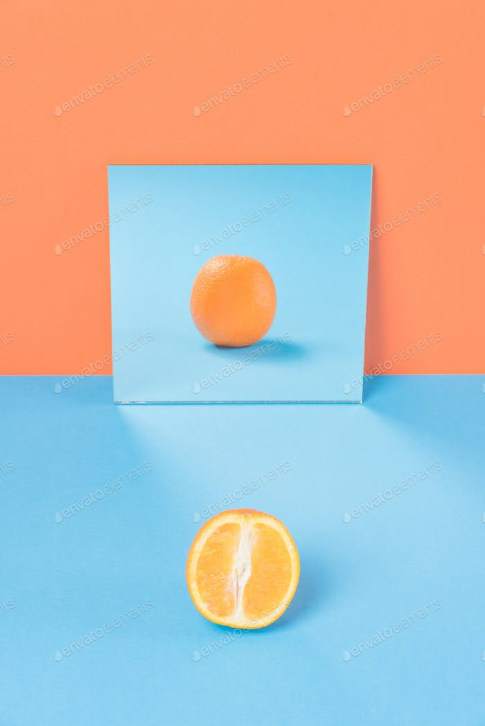 Orange on blue table isolated over orange background