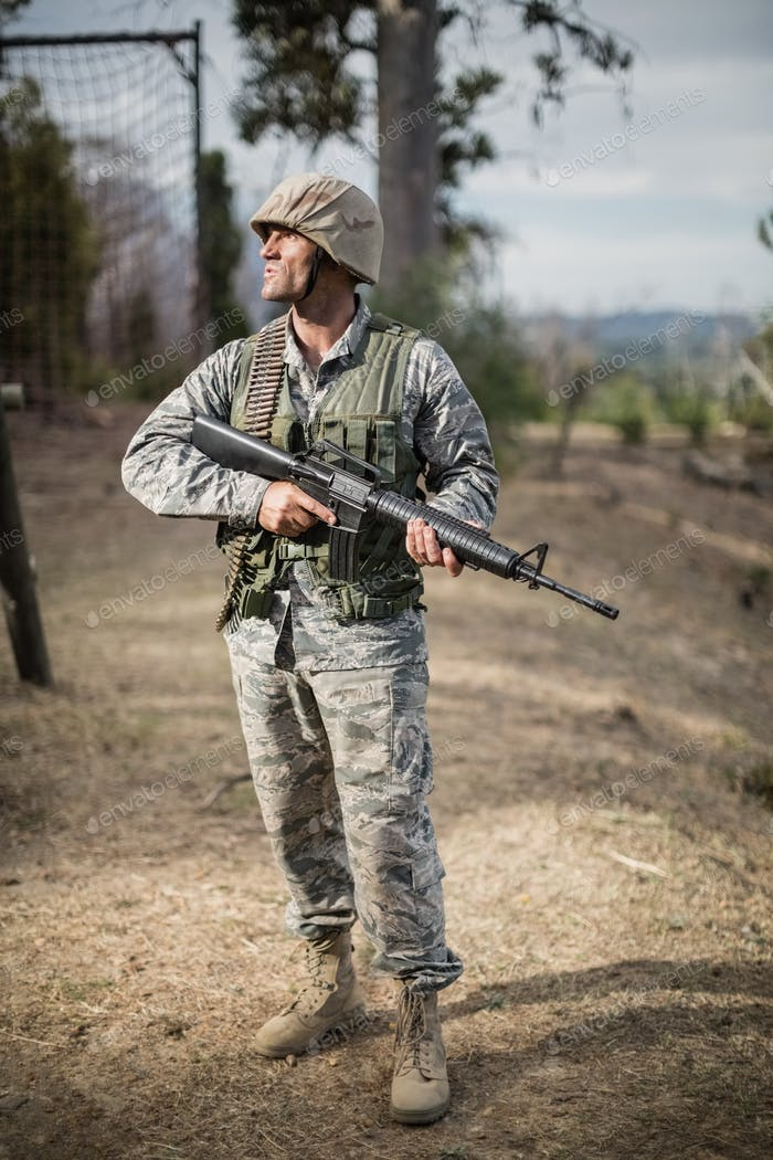 Military soldier during training exercise with weapon