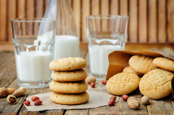 peanut butter cookies with glasses of milk