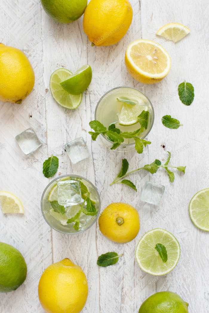 Homemade refreshing drink with lemon and lime juice and mint