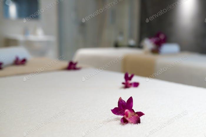 Flowers decorating massage beds
