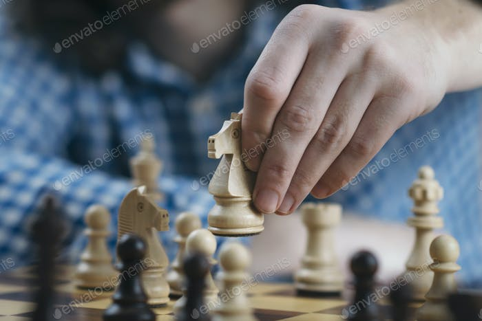 Hand of Chess Player Moving the Chess Piece