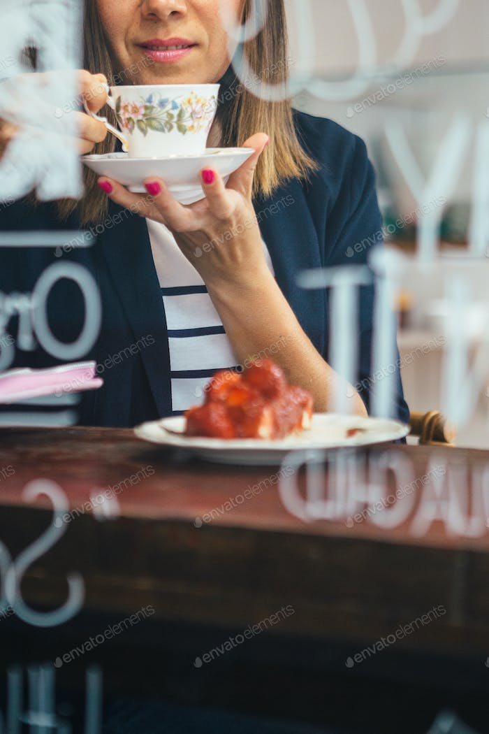 Close-up of woman drinking tea in cafe