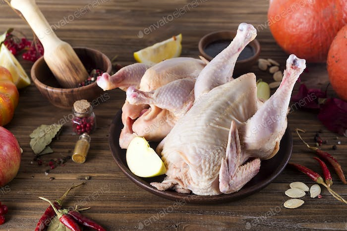 raw chicken fillets on wooden cutting board,