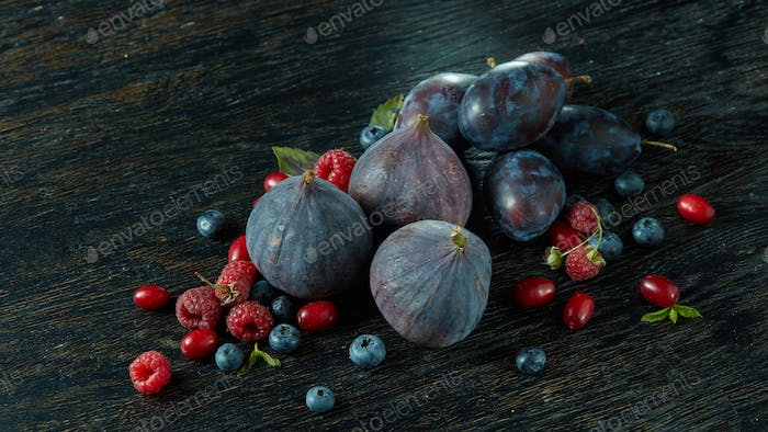 Healthy food. A lot of ripe juicy berries and figs