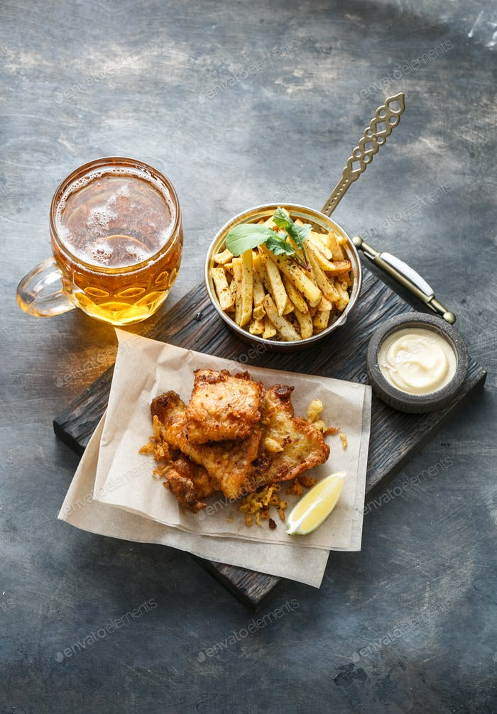 Buttered fish with potato and beer top view, copyspace