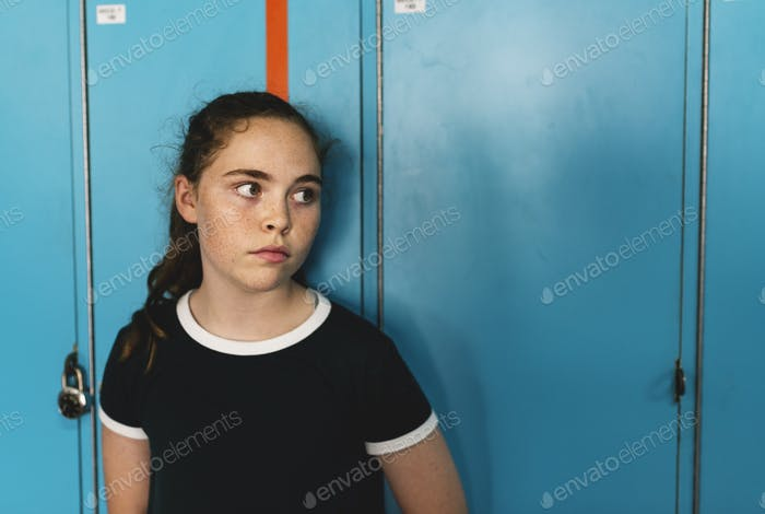 Student girl standing alone and staring