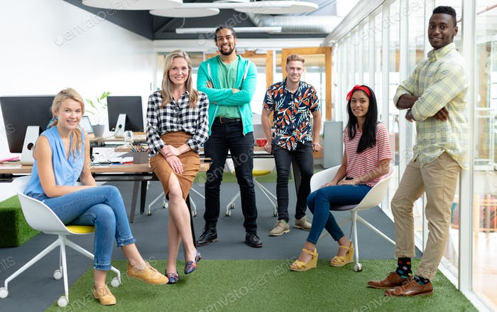 Front view of diverse business people looking at camera in a modern office