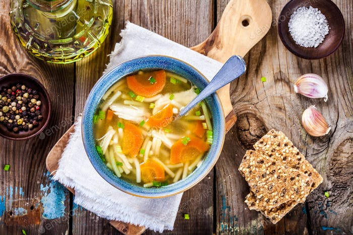 chicken noodle soup with carrots and green onions