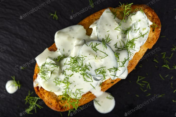 Bruschetta with cucumber and yogurt salad