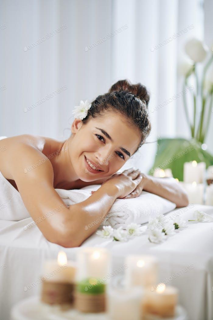 Happy woman in spa salon