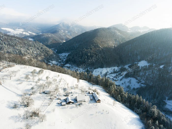 Aerial view of a village in winter.
