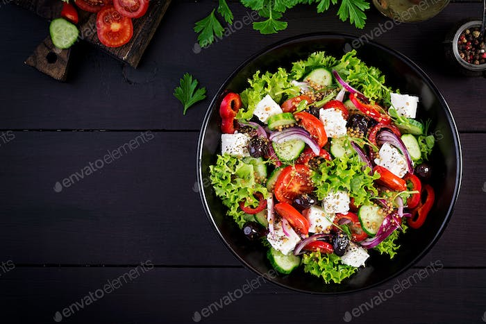 Healthy food. Greek salad with cucumber, tomato, sweet pepper, lettuce, red onion