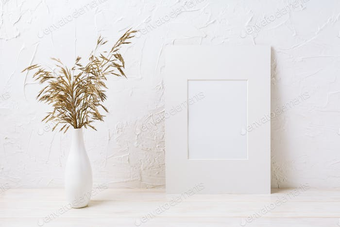 White mat frame mockup with dried grass