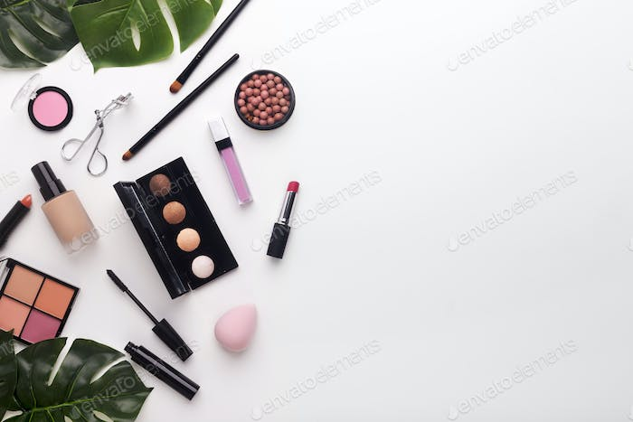 Flat lay composition of cosmetics for woman daily makeup