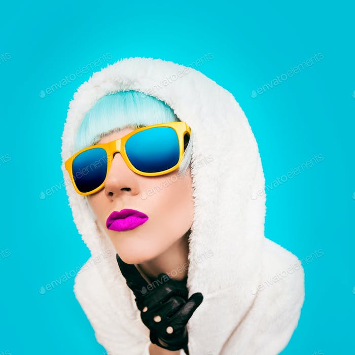 Fashion girl in a white hoodie on a blue background. winter Styl