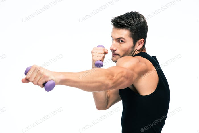 Sports man working out with small dumbbells