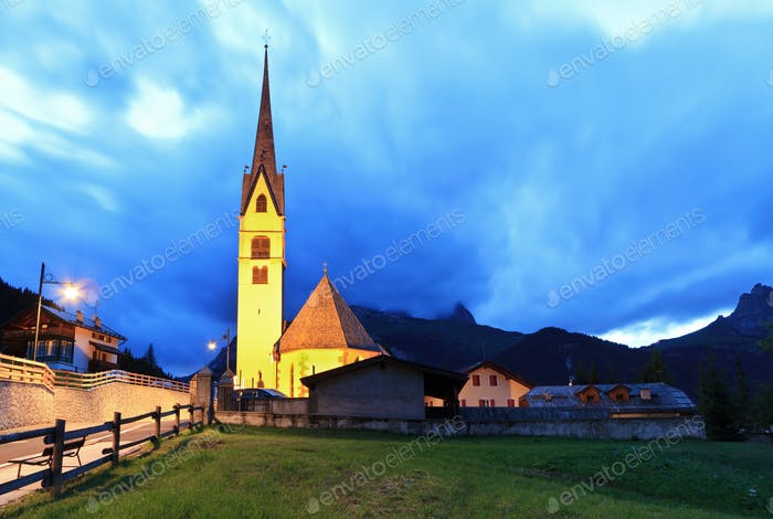 alpine church at evening