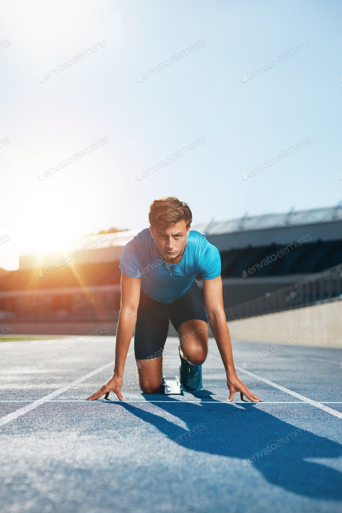Male athlete in starting blocks