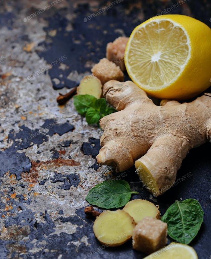 Ginger, lemon and mint on old dark background