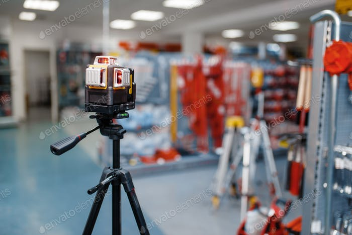 Laser level on tripod in tool store, nobody