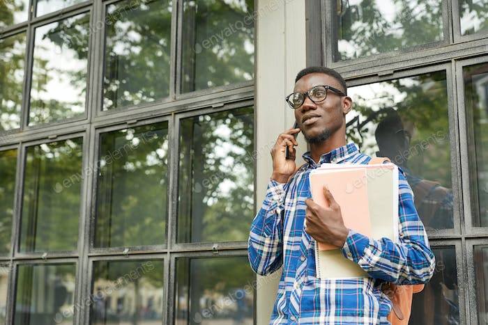 African-American Student Speaking by Phone