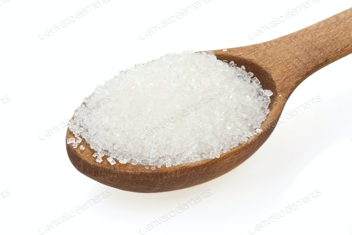 granulated sugar  in spoon on white