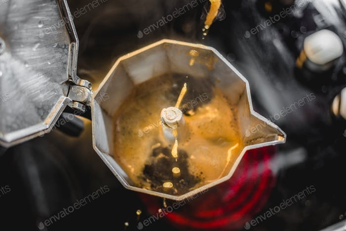 Italian Aluminum Coffee Maker Brewing a Fresh Dark Coffee on the