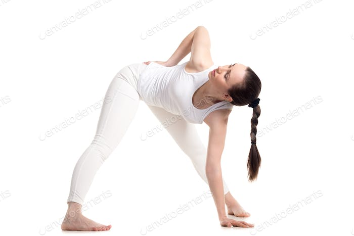 Yogi female doing Yoga Triangle pose