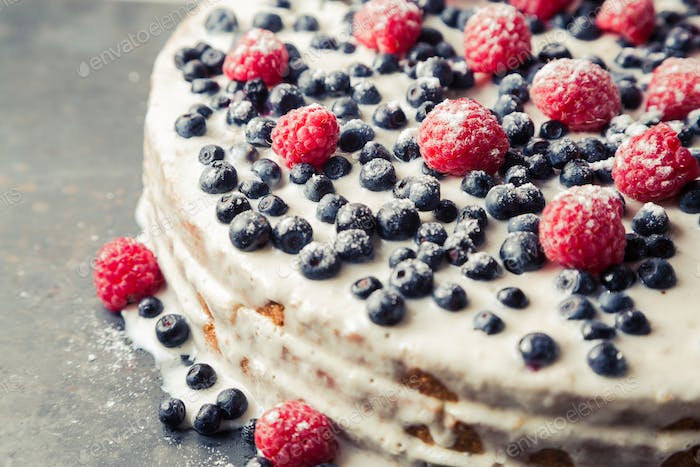 Homemade cake with blueberry and raspberry