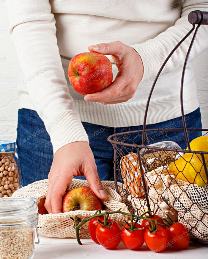 Plastic free concept - fresh vegetables and fuits  in textile bags and backet