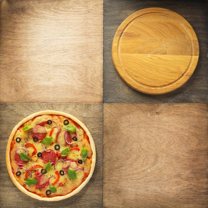 pizza and cutting board at wooden table