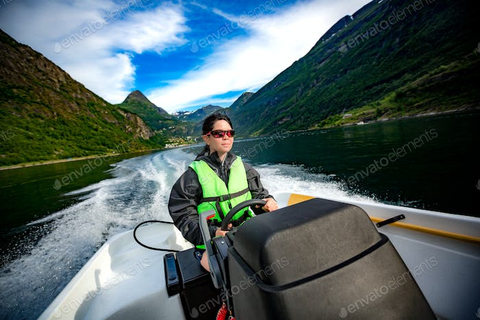 Woman driving a motor boat