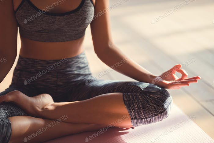 Young woman in a lotus pose