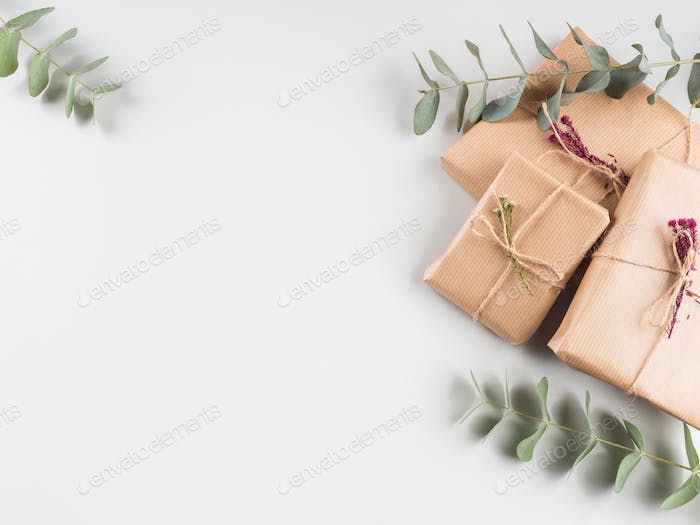 Gift boxes wrapped in craft paper with dried flowers