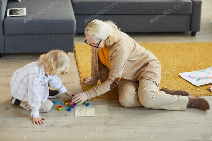 Grandmother playing with little boy