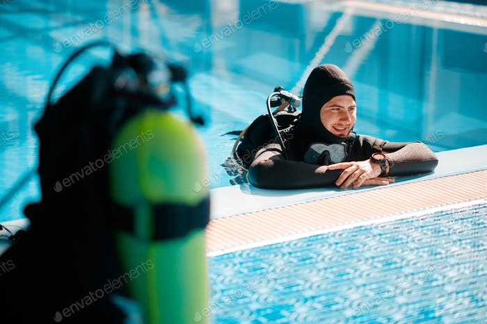 Oxygen tank at the poolside, scuba gear, diving