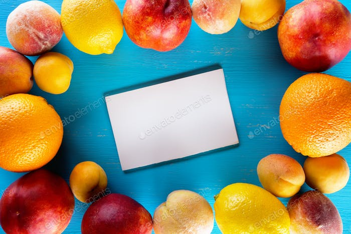 Fresh fruits on a blue wooden table