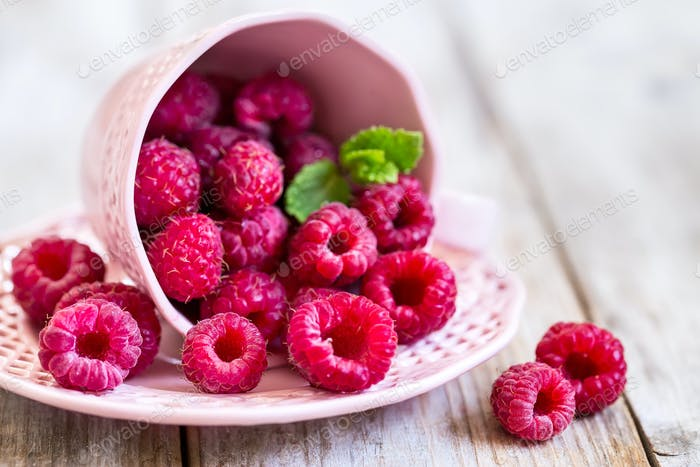 Raspberry in cup