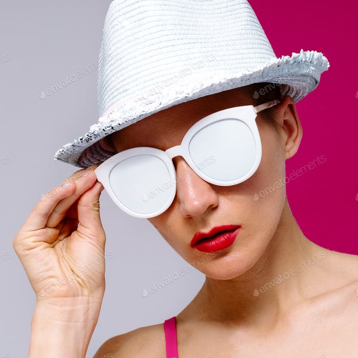 Model Pop Art style in sunglasses and a hat. Beach Minimal