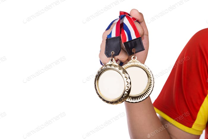 Athlete holding gold medals with ribbon with his hand