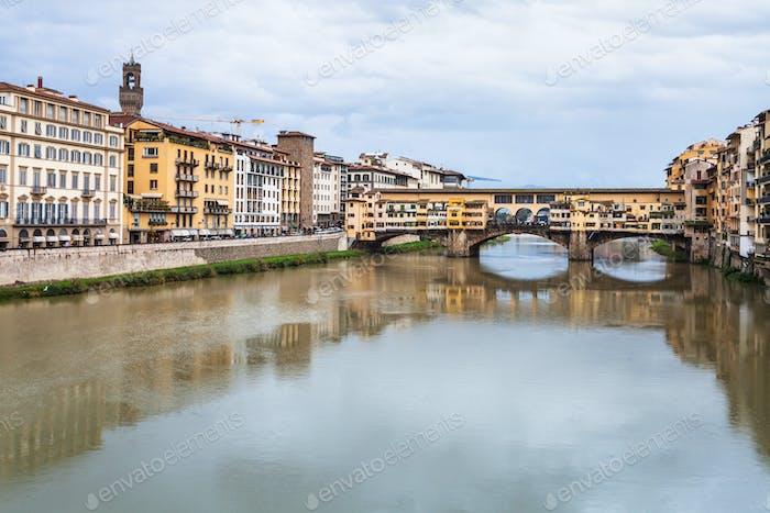 view of Ponte Vecchio over Arno river in autumn