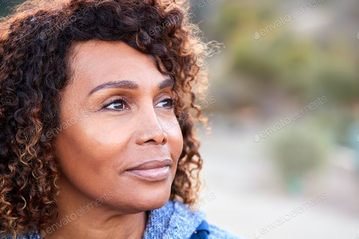 Outdoor Portrait Of Serious African American Senior Woman With Mental Health Concerns
