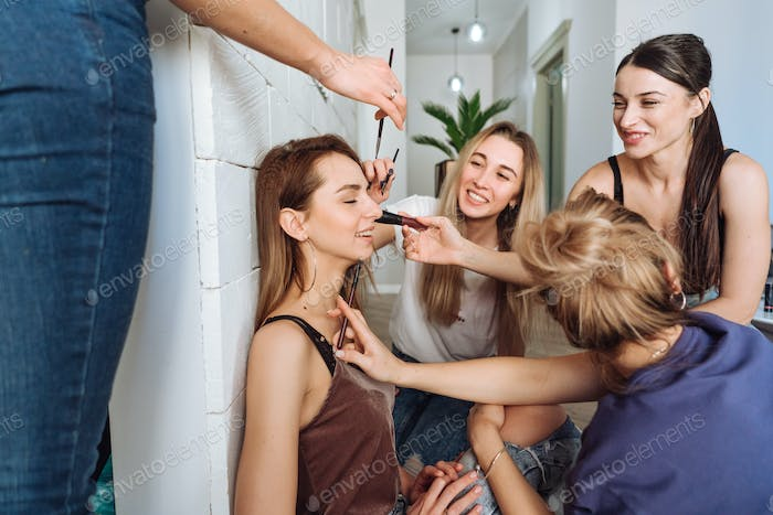Young beauty girls doing make up