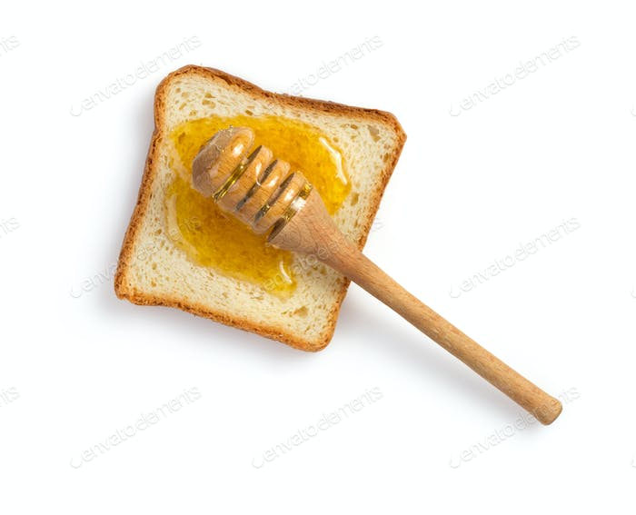 honey and bread on white