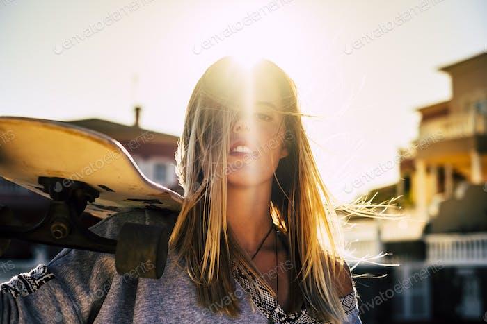 beautiful rebel blonde woman with skateboard