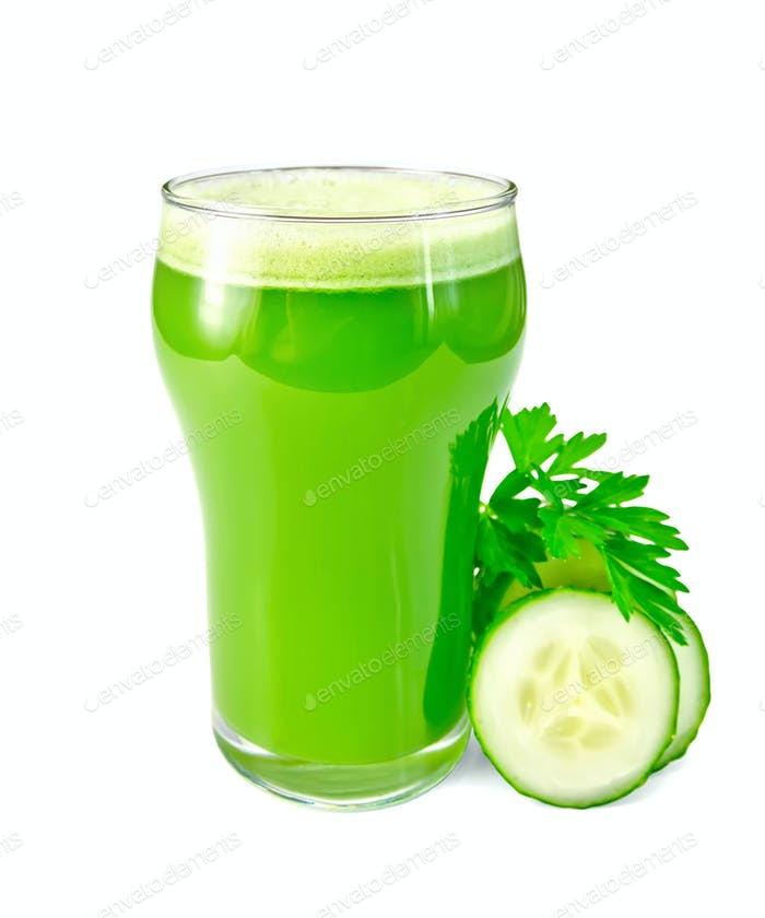 Juice cucumber in glass with cucumber and parsley