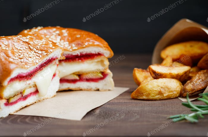 Burger with Camembert cheese and cowberry sauce