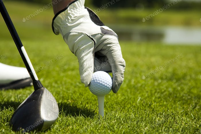 Adult Man Playing Golf Preparing to Hit The Ball